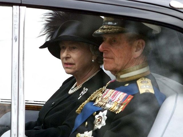 Queen Elizabeth II and Duke of Edinburgh after leaving Westminster Abbey following the funeral service of Queen Elizabeth, the Queen Mother.