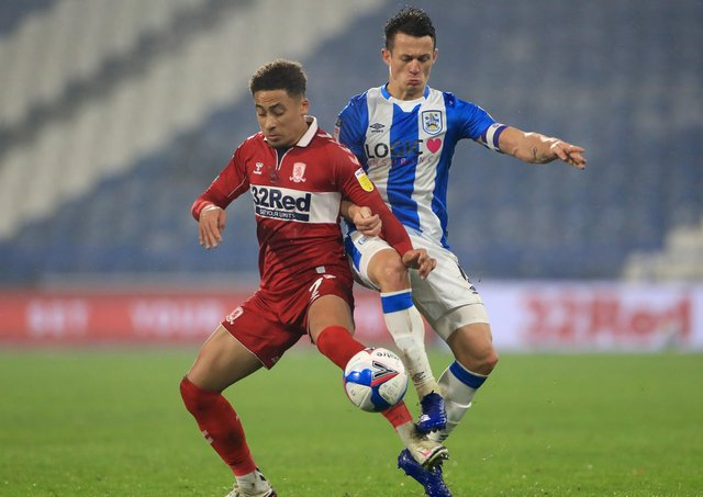Middlesbrough's Marcus Tavernier (left) and Huddersfield Town's Jonathan Hogg battle for the ball.