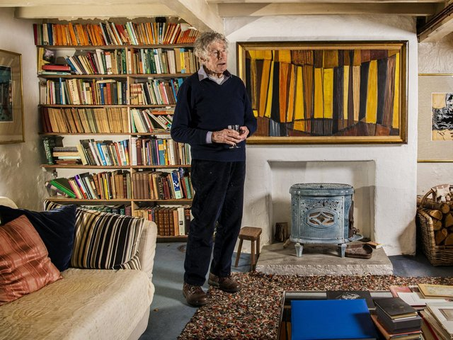 Art collector Ronnie Duncan in his home near Otley with Yellow Verticals by Terry Frost painted whilst in Leeds in the 1960s hanging on the wall in his front room. Picture: Tony Johnson
