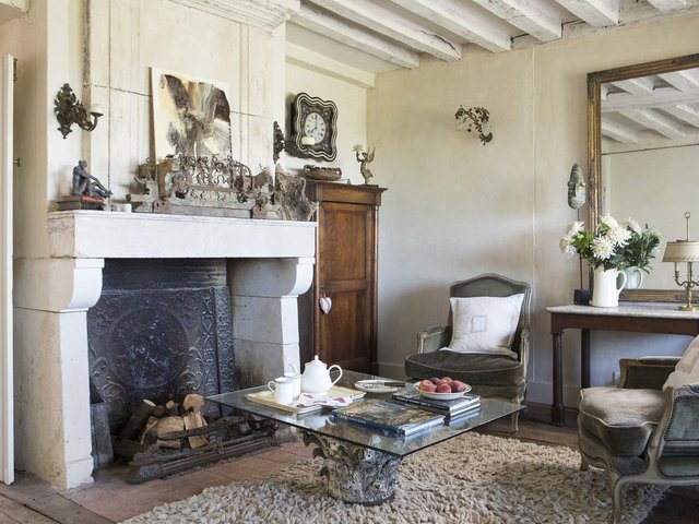 The reclaimed 17th century fireplace was bought from a French dealer. (Picture: Features Services).