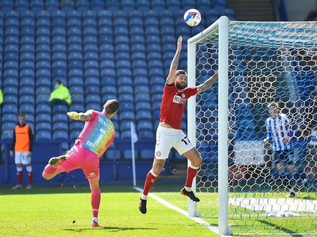 Henri Lansbury handles on the line to earn a red card, and concede a penalty at Hillaborough. Barry Bannan missed the spot-kick.