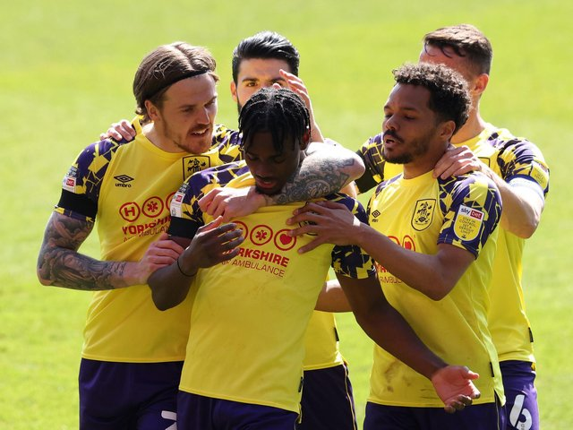 OPENER: Aaron Rowe and his Huddersfield Town teammates celebrate the first goal of the game at Nottingham. Picture: Getty Images.