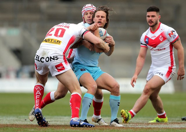 Wakefield Trinity's Jacob Miller  is tackled by St Helens. Picture: PA