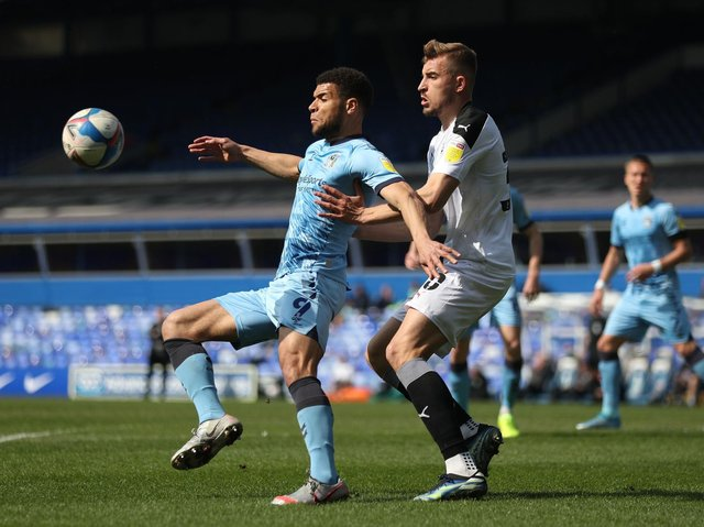 Coventry striker Max Biamou shields the ball in front of Barnsley FC rival Michal Helik. Picture: PA.