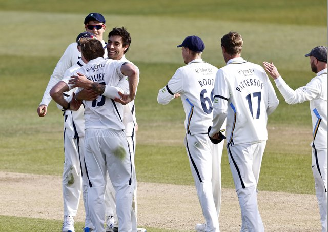 David Willey (L) is congratulated after taking the final Kent wicket. Pictures: Max Flego
