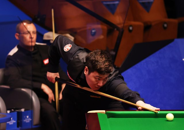 Yan Bingtao plays a shot during the Betfred World Snooker Championship in front of a limited crowd at the Crucible. Pictures: PA