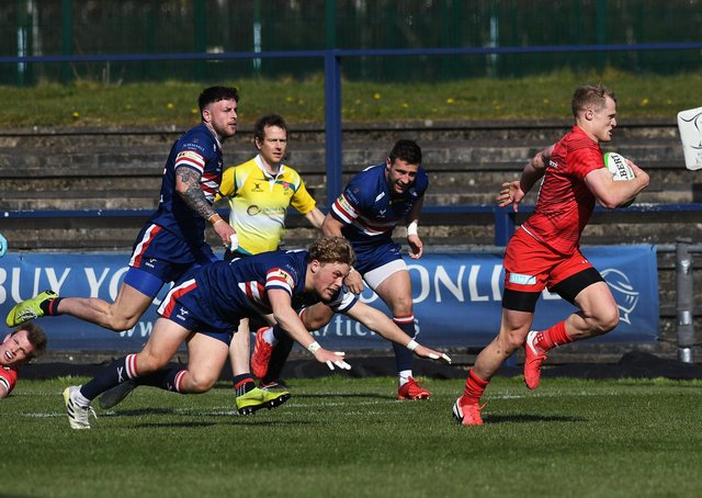 Doncaster's Gus Warr fails to stop Saracens' Aled Davies as her races away to score.  Pictures: Jonathan Gawthorpe