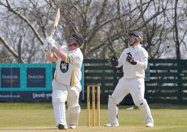 Contribution: Pudsey St Lawrence captain Chris Marsden, left,  scored 32 runs and took five wickets.. (Picture: Steve Riding)