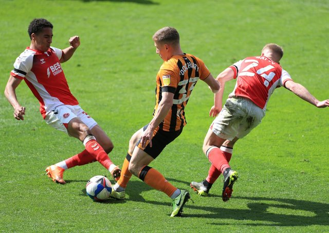 Hull City's Greg Docherty battles for the ball with Fleetwood Town's James Hill (left) and Daniel Batty (right) during the Sky Bet League One match at the KCOM Stadium, Hull. (Picture: PA)