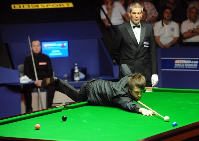 That missed blue - England's Judd Trump at the table during the final at the Betfred.com World Snooker Championships of 2011 against John Higgins (Picture: Anna Gowthorpe/PA)