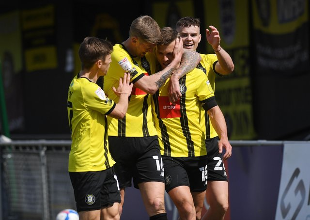 Harrogate's players, including Josh McPake, right, congratulate Jack Muldoon after he scored the opening goal. (Picture : Jonathan Gawthorpe)