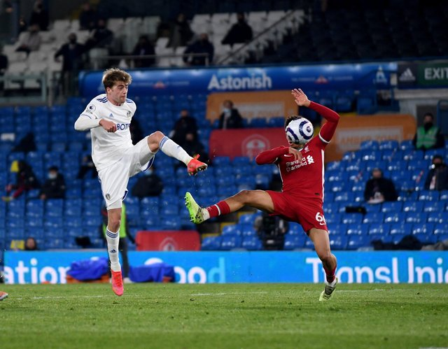 Leeds United's Patrick Bamford (left) denounced the proposed European Super League after his side's draw against Liverpool, one of the proposed member of the break-away league. He is pictured competing against out-of-sorts right-back Trent Alexander-Arnold.