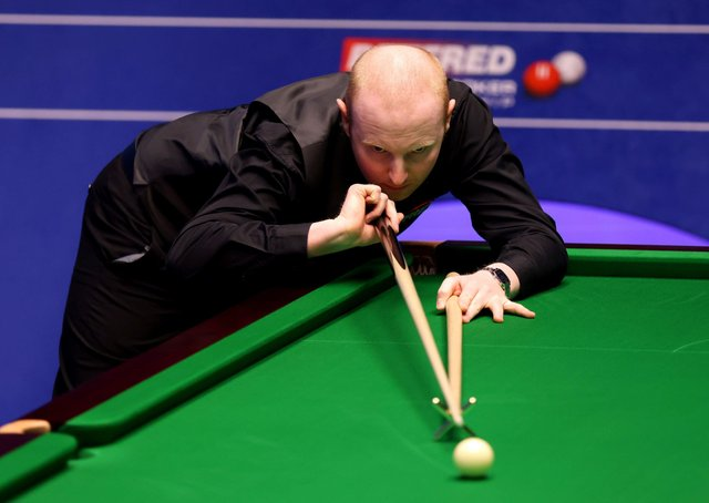 Anthony McGill uses the rest during his match against Ricky Walden at The Crucible on Monday. Picture: George Wood/PA