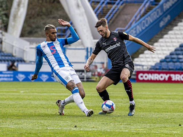 WING WONDER: Lewis Wing, pictured taking on Huddersfield Town's Juninho Bacuna, has impressed on loan at Rotherham United