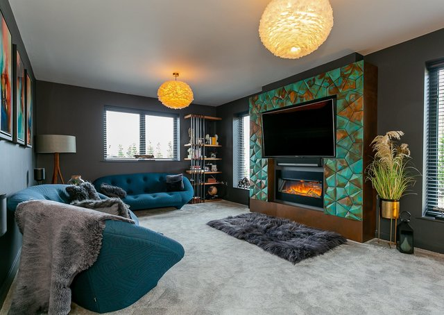 Overlooking Farnham boating lake, this contemporary family home has an on-trend colour scheme throughout, with a feature wall fireplace in the living room, five bedrooms and a home office. Contact: myringsestateagents.com