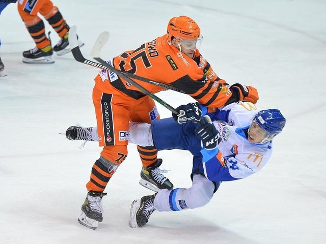 TAKE THAT: Steelers' Rob Dowd lands a hit on a Coventry opponent. Picture: Dean Woolley.