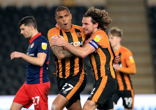 RRescue act: Hull City's Josh Magennis, left, celebrates scoring their side's equaliser against Sunderland in the League One match at the KCOM Stadium. (Picture: Mike Egerton/PA)