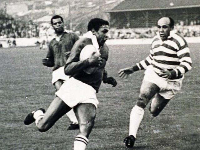 Clive Sullivan on the ball with Billy Boston and Colin Dixon in 1968.