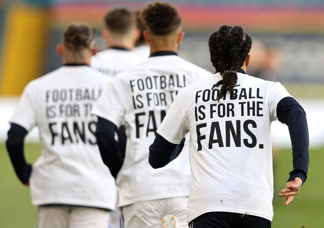 Clear message: Leeds United players wearing 'Football Is For The Fans' shirts as Liverpool arrive at Elland Road. Picture: PA