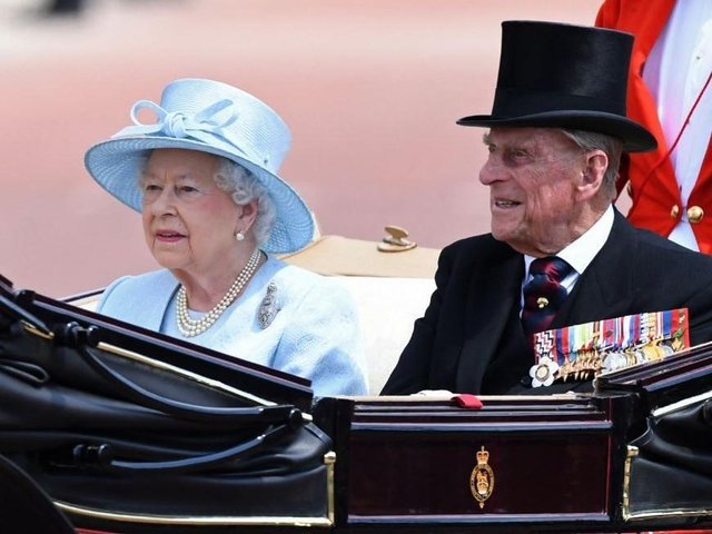 Queen Elizabeth and her late husband Prince Philip. Photo by CHRIS J RATCLIFFE/AFP via Getty Images.