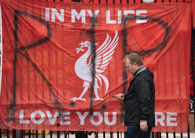 A banner is seen outside Liverpool's Anfield Stadium after the collapse of English involvement in the proposed European Super League.  (AP Photo/Jon Super)