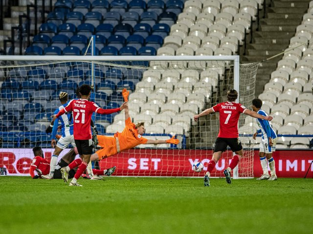DESERVED: The grounded Daryl Dike watches his goal find the net