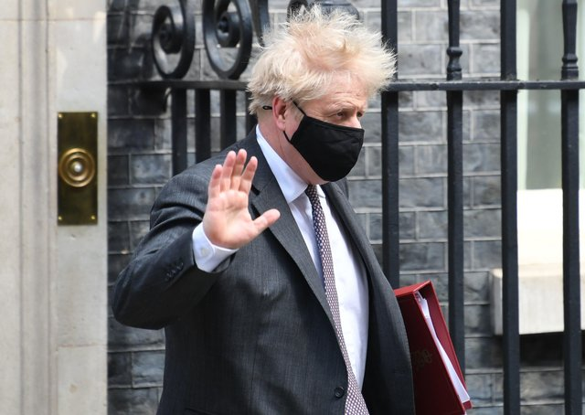 Prime Minister Boris Johnson leaves 10 Downing Street to attend Prime Minister's Questions at the Houses of Parliament in London. Picture: Stefan Rousseau/PA Wire
