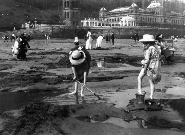 1913:  Bathers playing on the sands at Scarborough, a popular coastal resort in North Yorkshire.  (Photo by Hulton Archive/Getty Images)