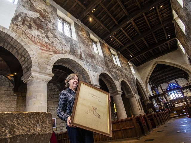Churchwarden Pamela Robb at St Peter's and St Paul's Parish Church in Pickering where medieval frescoes adorn the walls dating from 1450 but were painted over during the reformation in the 16th century. Picture Tony Johnson