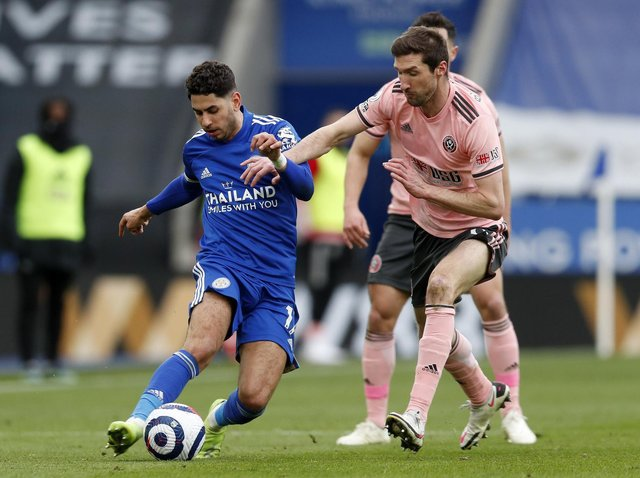 INJURY: Chris Basham closes down Ayoze Perez at Leicester City, in the last match he played