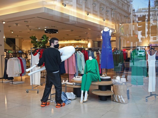 Stock photo of final touches being made to a display in a clothes store on Oxford Street, central London. Photo: PA