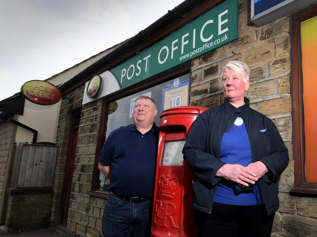 Alison Hall with her husband Richard pictured outside the Post Office, Halifax Road, Liversedge Picture: Simon Hulme