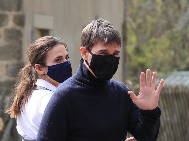 Actor Tom Cruise waves to onlookers as he walks to the set of his latest project, which has been filming in the village of Levisham in the North York Moors. (PA).