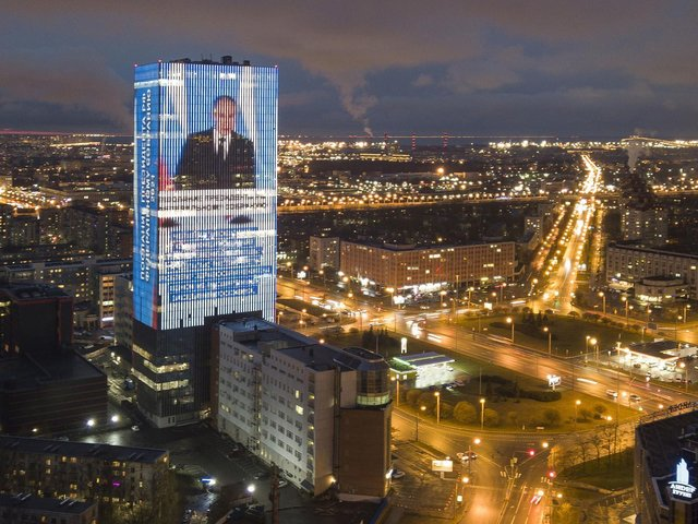 An electronic screen, installed on the facade of a business tower, shows an image of Russian President Vladimir Putin speaking during his annual state of the nation address and a quote from his address in St. Petersburg, Russia, Wednesday, April 21, 2021. (Picture: AP/Getty)