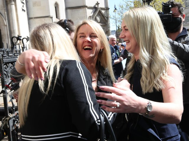 Former post office worker Janet Skinner (centre), from Hull, with her niece Hayley Adams (right) and her daughter Toni Sisson, celebrating outside the Royal Courts of Justice, London