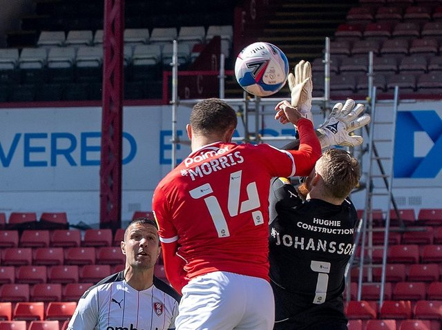 Barnsley's Carlton Morris challenges Rotherham United keeper Viktor Johansson for the hosts' controversial early opener at Oakwell. PICTURE: BRUCE ROLLINSON.