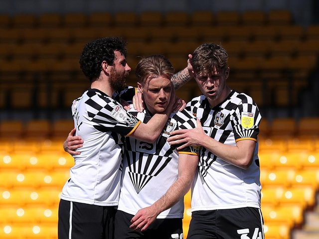 WINNING STRIKE: Tom Conlon of Port Vale celebrates with David Worrall and Will Swan after scoring their side's second goal from the penalty spot during the Sky Bet League Two match between Port Vale and Bradford City. Picture: Getty Images.