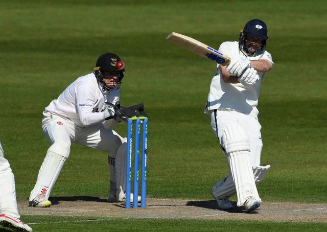 Yorkshire's Adam Lyth pulls for four to reach his 50 at Hove. (Pictures: Mike Hewitt/Getty Images)
