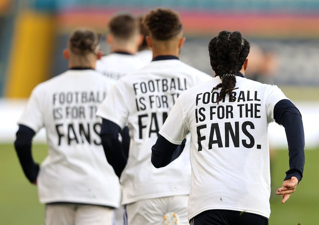 Leeds United players wearing 'Football Is For The Fans' shirts. Picture: PA.
