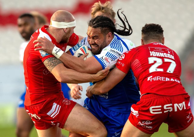 Leeds Rhinos' Konrad Hurrell is held by Hull KR duo Dean Hadley and Luis Johnson at Craven Park.  Pictures: Bruce Rollinson