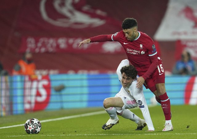 ANOTHER WORLD: Real Madrid's Alvaro Odriozola, left, is challenged by Liverpool's Alex Oxlade-Chamberlain during a Champions League quarter final second leg match at Anfield last week. Picture: AP/Jon Super.