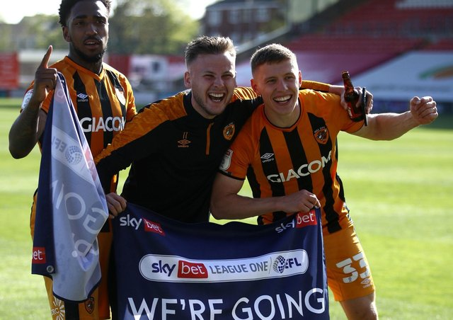 Going up: Hull City's Malik Wilks, James Scott and Greg Docherty celebrate promotion. Pictures: PA