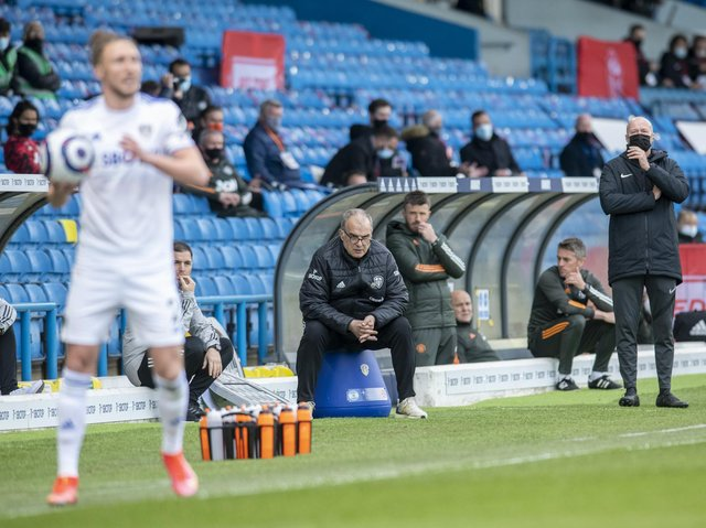 IMPRESSED: Marcelo Bielsa watches intently from his bucket as Luke Ayling prepares to take a throw-in