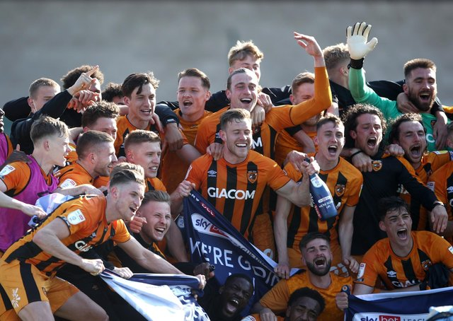 Hull City players celebrate promotion to the Championship. Picture: PA.