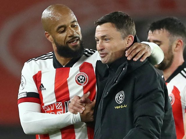 Sheffield United match-winner David McGoldrick, left, and interim manager Paul Heckingbottom celebrate at full-time following Saturday's win over Brighton. Pictures: Getty Images