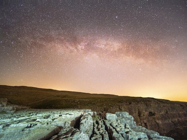 Bruce Rollinson's image of the Milky Way above Malham Cove in the Yorkshire Dales. Technical details: Nikon D6, 14mm f2.8 Nikkor,  20sec @ f2.8, 5000 iso.