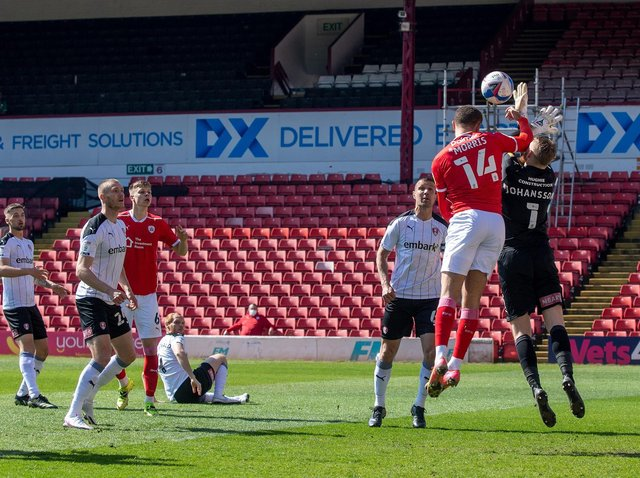 Rotherham United keeper Viktor Johansson is caught by the elbow by Barnsley rival Carlton Morris en route to the Reds player scoring in Saturday's controversial game at Oakwell. PICTURE: BRUCE ROLLINSON