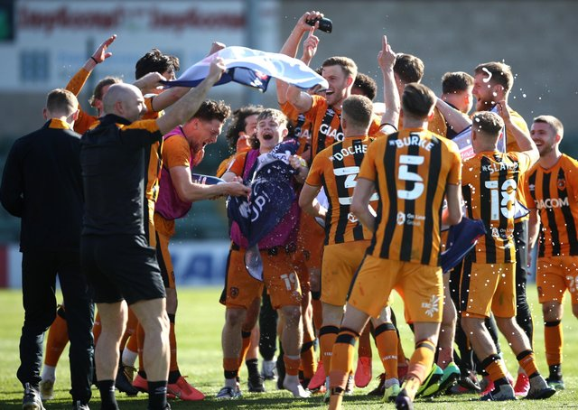 Champagne moment: Hull City players celebrate promotion to the Championship after the final whistle against Lincoln. Picture: Tim Goode/PA Wire.