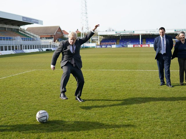 Prime Minister Boris Johnson kicking a football during a visit to the Hartlepool United Football Club, in Hartlepool, ahead of the May 6 by-election. Picture: Ian Forsyth/PA