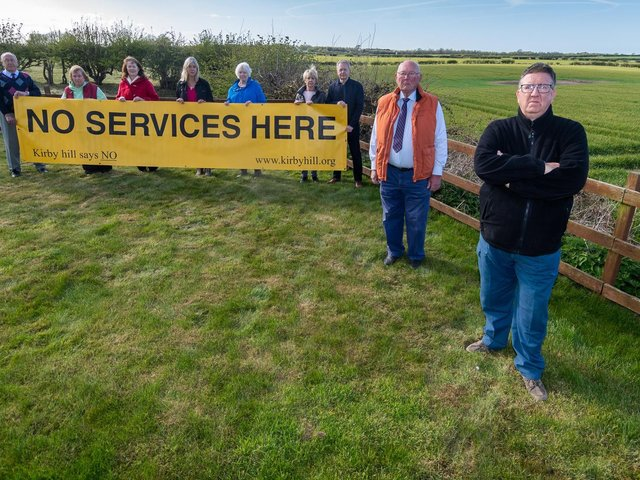 A group of residents from Kirby Hill, near Boroughbridge, North Yorkshire, have been involved in a 25-year battle against a motorway service station being built in their area have been dealt a blow after a planning inspector ruled the scheme (which has been rejected multiple times before) can go ahead. Pictured Residents from Kirby Hill and members of RAMS - Residents Against Motorway Services action group (left to right) Geoff Craggs, Wendy Wilby, Judith Owens, Pam Thirkell, Andrea Cope, Jayne and Steve Cove, Cllr Robert Windass, and Gareth Owens. Picture: James Hardisty.